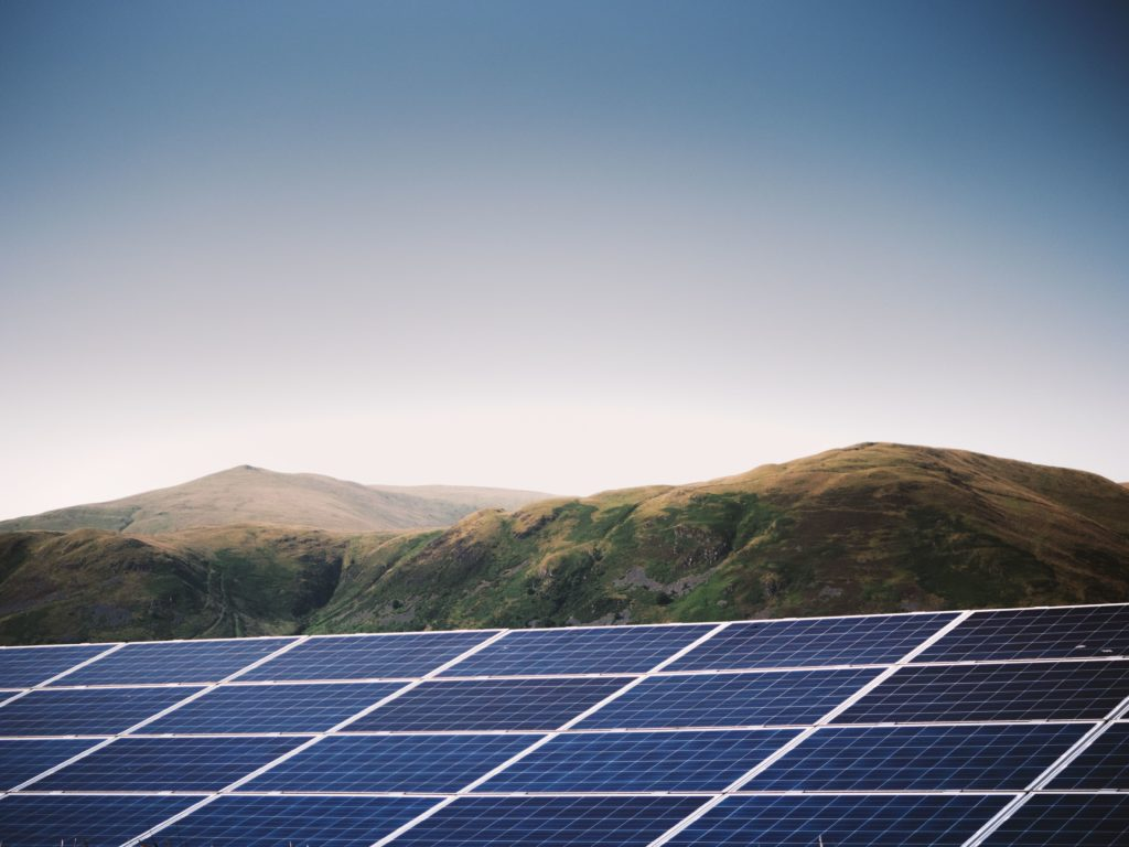 Scottish solar farm with rugged hills in the background